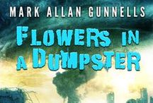 Mark Allan Gunnells' Flowers in a Dumpster / Seventeen Tales to Frighten and Enlighten The world is full of beauty and mystery. In these 17 tales, Gunnells will take you on a journey through landscapes of light and darkness, rapture and agony, hope and fear.