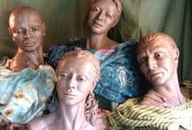 Monument to Humanity / THese four humans of diverse ethnicitys