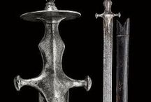 Indian swords (Only historically accurate) / Mediæval and modern period swords from Indian subcontinent and neighbouring regions. Containing Indian, Indo-Persian (Persian influenced northern India), Sikh, Mughal and Afghan cultures. Swords include: tulwar, pulwar, shamsir, shamshir shikargar, patissa, khanda, tegha, pala, saif, pata, sos(s)un pat(t)a(h), kora, khukuri, kastane, sapola, dha, zulfikar.  Also a bow and a few gunpowder weapons, until I find enough relatives to them to make a new board.