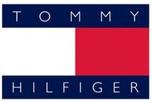 """TOMMY HILFIGER  / Tommy Hilfiger is an American brand of sportswear easy-to-wear, which has collections of total look trendy for men, women, child, inspired by the University, the College of the States and to the sport of golf, which he dedicates a line of sportswear .  My style is """"cool"""" and is reflected in the contemporary instant communication of the logo that distinguishes a rectangle half white and half red, framed above and below by two blue bars bearing the name of Tommy Hilfiger."""