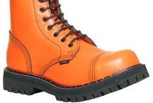 Steel Boots / Steel Shoes & Boots - The only steel toe cap boots in 17 colors for punk and goth fashion. New orange, red and pure blue steel toe cap boots, biggest competitor for Dr Martens, Underground, Rangers and Tredair. Screw and Air sole in 3 eyelet, 6 eyelet, 8 eyelet, 10 eyelet, 15 eyelet and 20 eyelet boots, very wide range of fashion steel cap street footwear. More different models than Gripfast, Grinders or Gladiator boots.