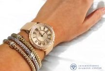 Arm Candy / International Diamond Center has a large selection of  men and woman's designer watches from Tag Heuer, Tissot, Hamilton to Michele in a variety of colors and shapes.