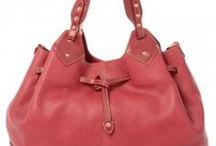 The Bridge. Red handbags. / A leather handbag is the perfect way to makeover any look and inject an element of timeless style. The current range from The Bridge offers fashion forward options, meticulously designed and constructed with 100% leather to promise a leather handbag of the highest quality that will last for years to come.