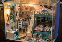 Doll Houses / A dollhouse or doll's house is a toy home, made in miniature. For the last century, dollhouses have primarily been the domain of children but their collection and crafting is also a hobby for many adults.