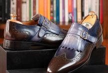 Monkstraps / A monk shoe is a style of shoe with no lacing, closed by a buckle and strap. It is a moderately formal shoe style.