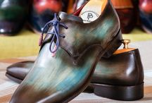 Derby Shoes / A derby shoe (also called bucks or Gibson) is a style of shoe characterized by shoelace eyelet tabs that are sewn on top of a single-piece vamp.