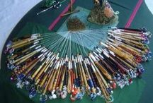 Lacemaking Bobbins and Bobbinlace Accessories / Manufacturers of lacemaking bobbins and various accessories such as prickers, pin lifters, dividers, etc. Glass spangle beads also belong in this category, although seldom produced by a bobbin turner.