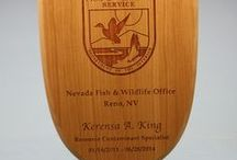 Unique Plaques & Awards / Plaques/Displays/Awards made from Wood, Leather, Metal or Acrylic. Custom made in Colorado, USA but shipped to anywhere in the world. We can make small desk-top awards or larger wall displays and everything in between. Please contact us for a price quote: Sales@ucppromo.com, 970-282-9591
