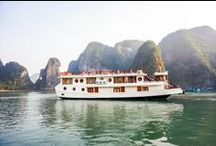 3 STARS ORIENTAL SAILS CRUISE / The junk boasts rattan & wooden furnishings, a multitude of windows for amazing views from the inside, and a panoramic sundeck allowing different activities with the beauty of Halong Bay as a backdrop.