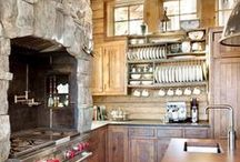 Rustic / Log cabin type, made from tree branches and trunks-think cabin in the woods.