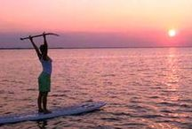 Standup Paddle Boarding / Some folks call Standup Paddle Board SUP.  Kind of like walking on water. For sure more on-water recreation and fun!