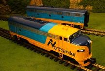 """MTH RailKing G Gauge / 1:32 scale American-prototype garden railway models equipped with sound, smoke, and DCS command control, suitable for outdoor or indoor, DC or AC operation. RailKing One Gauge items are identified with item numbers that begin with """"70""""."""