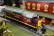 """MTH Premier O Gauge / Full O scale models, 1/48 the size of their prototypes and as detailed as we can reasonably make them — offering O gauge's finest combination of detail, realism, and performance. M.T.H.'s Premier items are identified with item numbers that begin with """"20"""" for Hi-Rail models with item numbers ending in """"-1"""" and """"22"""" for Scale Wheel models."""