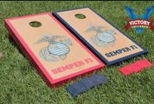 "Military Cornhole Themes / Our specialty cornhole games are made proudly in the USA. Each game set comes with two 24""x48"" regulation boards with folding legs, a complete bag set (8 bags), and a FREE string pack to carry the bags (A $10 value!)"