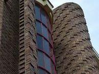 Amsterdamse School / The Amsterdam School (Dutch: Amsterdamse School) is a style of architecture that arose from 1910 through about 1930 in the Netherlands.  From 1920 to 1930 different parallel movements developed: Traditionalism (Kropholler, partly Berlage) Expressionism (de Klerk, Kramer) De Stijl (Rietveld, Oud, van Doesburg) Rationalism (van Eesteren, van Tijen, Merkelbach) Constructivism (Duiker, van der Vlugt) The specific Brick-Cubism (Dudok, Berlage).
