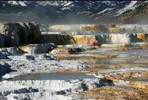 Mammoth Hot Springs / Located near Gardiner, Montana and the North Entrance to Yellowstone, Mammoth Hot Springs is a major hub for a variety of year-round activities. The hot springs found here are some of the most dynamic in the park and a network of boardwalks provides visitors with access to these unique thermal features. During the winter months the warm springs and frigid temperatures create some incredible landscapes along the massive terraces.