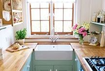 Kitchen / A Pink/Teal/White colour scheme with warm wooden worktops and a blousy vintage floral theme.