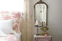 Bedroom / Light, warm and cosy with a soft, feminine, romantic, french feel. Faded glamour. Muted warm pastel tones - dusky pink with green/blue accents. Ornate mirrors, shabby-chic furniture, delicate chinoiserie patterns, pretty quilts & cushions. A floral/butterfly/bird theme.