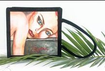 art U wear / For the many moods of a woman hand paintedoriginals oil on canvas  Hip + Edgy works of Art Handmade – excellent fabrication Silk Velvet exterior Cotton lining Magnetic lock 4 interior pockets (3 open, 1 zipper) Additional accessory signature bag Additional protective coverbag Light weight + soft