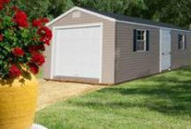 "Vinyl Standard Buildings / Designed to give you a maintenance free yet elegant storage shed for any outdoor space. Featuring 7/16"" sheathing on the walls and roof for extra durability, added with the attention to detail as well as price, you can't go wrong with the Vinyl Standard."