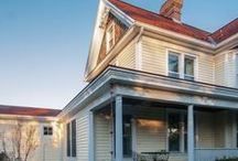 Vienna Historic Farmhouse / Architect: Seth Ballard, AIA, NCARB -- Vienna, VA -- Our client was relocating from the South Carolina area into the DC area and hired us to help them to find a home to purchase and renovate. We were lucky to find this charming Victorian Farmhouse. We have developed a multi-phase plan to help them to grow into the house over time. The first phase is now complete and includes an expanded family room and new main level master suite. We expanded the porch roof to encompass the family room addition.