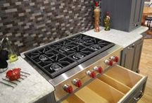 Custom Cabinetry with Range Tops / http://www.kountrykraft.com/