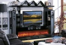 Electric Fireplaces Entertainment Centers / For many years people have enjoyed a fireplace and their entertainment centers as separate units. With new technology people can now enjoy their fireside and their entertainment center with a media electric fireplace as one unit.