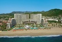 """Now Amber Puerto Vallarta / Now Amber Puerto Vallarta is ideally located just a few steps away from famous boardwalk """"El Malecón"""" and its vibrant ambiance full of art galleries, shopping area and amazing night life. All luxurious accommodations are complete with chic decorations. All suites overlook the Pacific blue waters and golden sand beach. Some suites feature swim-out suites with direct access to the pool. https://www.unlimitedvacationclub.com/Resorts/Now/NowAmberPuertoVallarta"""