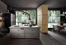 Minà • The kitchen • / Minà combines the highest expressions of tradition and technology in a new-concept multifunctional island. The essence and details of its form draw on the purest archetype and have strong proto-industrial connotations.