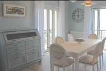 """English Mood • Beachfront apartment in Laigueglia - Liguria • / The apartment, which overlooks the sea, has become a dream place following the restructuration. Andrea Castrignano chose the furniture from the English Mood collection.  This choice of furniture, with its romantic flavour, was able to provide the apartment with an elegant and delicate atmosphere.   The living area with adjoining kitchen is characterized by """"marine"""" shades  such as the Aurora Blue and White Chalk, which make the room particularly bright."""