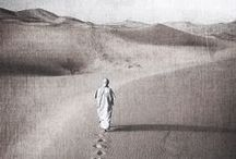 """Q u i e t⠀S a n d s . / """"The hot sand looks quiet under the nomad's feet, and the dust settles on his clothes while they look for a new home."""""""