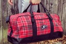 College Branded Bags / Tartan, checked, or houdstooth patterns with leather accents and adjustable leather strap duffle bag. Wear it cross body, for a weekend away or to the gym, and even tailgating on gameday. Fits a phone and toiletries, shoes, clothes. Front pocket and inside mesh pockets. This Product Makes a Great Groomsman, Graduation, or Holiday Gift for any college or alumni fan!