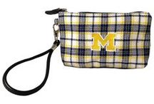 College Branded Wristlets / Wallet sized clutch in custom collegiate prints and embroidered logo.  Internal pocket fits most smart phones.  Perfect for keys ID's and other game day essentials.  Meets allowable stadium security guidelines. See all at http://www.thehonoursociety.com/wristlets