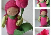Bonecas de pano ou feltro. / by Rosi Ferreira