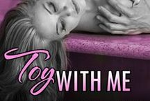 Toy With Me - MF standalone / Construction foreman Greg loves Anna, his wife of twenty years. He's planning a romantic weekend away reconnect with Anna before their nest empties. Work gets in the way, and one lovemaking session seems just like the next...  Until Greg buys a set of toys and introduces Anna to a whole new world of pleasure. Can Greg whisk Anna away for a sexy weekend to remind them of the close couple they used to be?