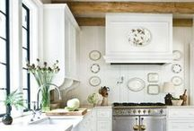 Farmhouse Decorating Ideas / Farmhouse decorating ideas inspired by shades of white, warm woods, chippy furniture, slipcovers, grain sacks ironstone, and flowers.  #farmhousestyle #farmhousedesign #farmhouselove #decoratingwithwhite #ironstone #grainsack #fixerupperstyle #decoratingwithneutrals #white