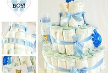 Custom Made Diaper Cakes / Original and personalized diaper cakes with baby accessories as a gift for a newborn.