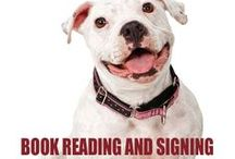 Dogs Who Read / Celebrating the star of the novel The Weredog Whisperer (Cleo Tidwell Paranormal Mystery, 2) by Susan Abel Sullivan, Luna! A white pit bull terrier!