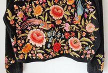 Art of embroidering / Em·broi·der·y < em·broi·der·ies  E·lab·o·rat < e·lab·o·rat·ion; as in telling a story.