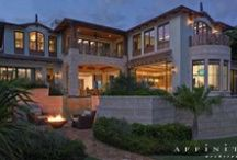 Rustic Caribbean Estate / This residence evokes the character of the U.S. Virgin Islands and lower islands of the Caribbean with exteriors of rough coral stone and dark stained wood. Entry through a full height wall and doorway into an exterior courtyard foyer leads to a house surrounded by an elevated free form pool and rock gardens.