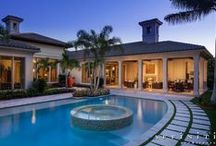 Symmetrical Transitional Mediterranean / This 5,837 s.f. one-story residence features an open plan designed for empty-nester country club entertaining.