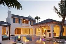 Transitional Caribbean / Classical massing and clean Dutch West Indies Architecture are contrasted by modern pool and landscape elements. The interior continues this with pocketing hidden doors, clean museum-like finishes and detail
