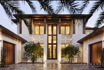 Tropical Rustic / Simple clean roof overhangs and vertical wood column detail anchor theme.