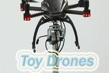 Toy Drones / Dozens of companies have sprung up in the last few years making remote controlled, mini-aircraft mounted with cameras, that are increasingly being used for commercial and even entertainment purposes.  Visit http://www.drone365.com / by Toy Drones