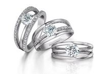 """Evolym / The words, """"My Love"""" written in reverse, the Shimansky Evolym ring is a reflection of your love and commitment. Handcrafted with precision, it has the appearance of a delicately set solitaire diamond, yet it is firmly secured between three bands. Its 360 degree exposure to light allows it to radiate a true brilliance."""