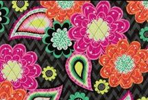 Inspiration: Ziggy Zinnia / Bright pink and orange zinnias are scattered across the tonal gray chevron ground. Paisleys and flowers in mint and yellow accent the print. Shop Ziggy Zinnia at www.verabradley.com. / by Vera Bradley