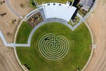 Labyrinth / In 2015 Fairsing Vineyard completed construction of a tasting room & exterior space. Nathan Good of Nathan Good Architects honored our Celtic heritage with a design that included an in-ground circular Labyrinth (meditative walking path). The labyrinth as an idea is closely related to the Celtic knot.  Where a knot is formed from a single continuous line that winds and weaves through a design, a labyrinth typically has a starting & an end point with many switchbacks along a continual line.