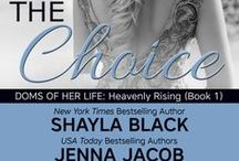 Doms Of Her Life: Heavenly Rising Collection / SUPER-SEXY SERIALIZED COLLECTIONS OF A TEMPESTUOUS WOMAN AND TWO DOMS EACH VYING TO MAKE HER HIS OWN. Written by Shayla Black, Jenna Jacob & Isabella LaPearl