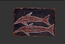 Groote Eylandt / Groote Eylandt - mostly aborignal bark paintings. The paintings from this island (which was once Dutch territory, therefore still the old name) have a dark blue/black background which comes from the mineral Mangan. It was exported from this island worldwide.
