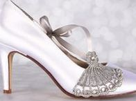 White Weddings / Don't let anyone tell you that a white wedding is boring! There are so many fun ways to give this traditional wedding color your own bridal style colored wedding ideas and wedding shoes  | Custom designed handmade wedding shoes • Creating the bride's dream wedding shoe with bling, lace, flowers, bows, butterflies & more | CustomWeddingShoe.com